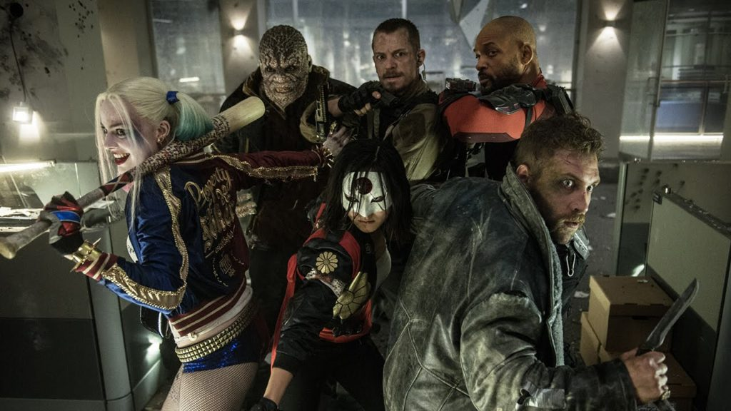 """From Left- to- right: Margot Robbie as Harley Quinn, Adele Akinnuoye-Agbaje as Killer Croc, Joel Kinsman as Rick Flag, Will Smith as Deadshot, Karen Fukuhara as Katana, and Jai Courtney as Captain Boomerang in """"Suicide Squad."""" Photo courtesy of YouTube"""