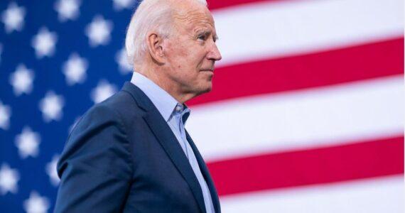 Joe Biden infront of flag